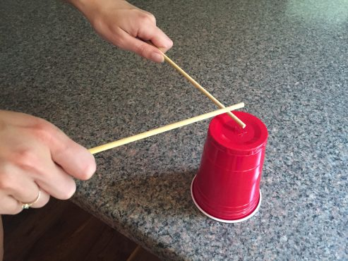 Don't have room for big buckets? Use cups and chopsticks!